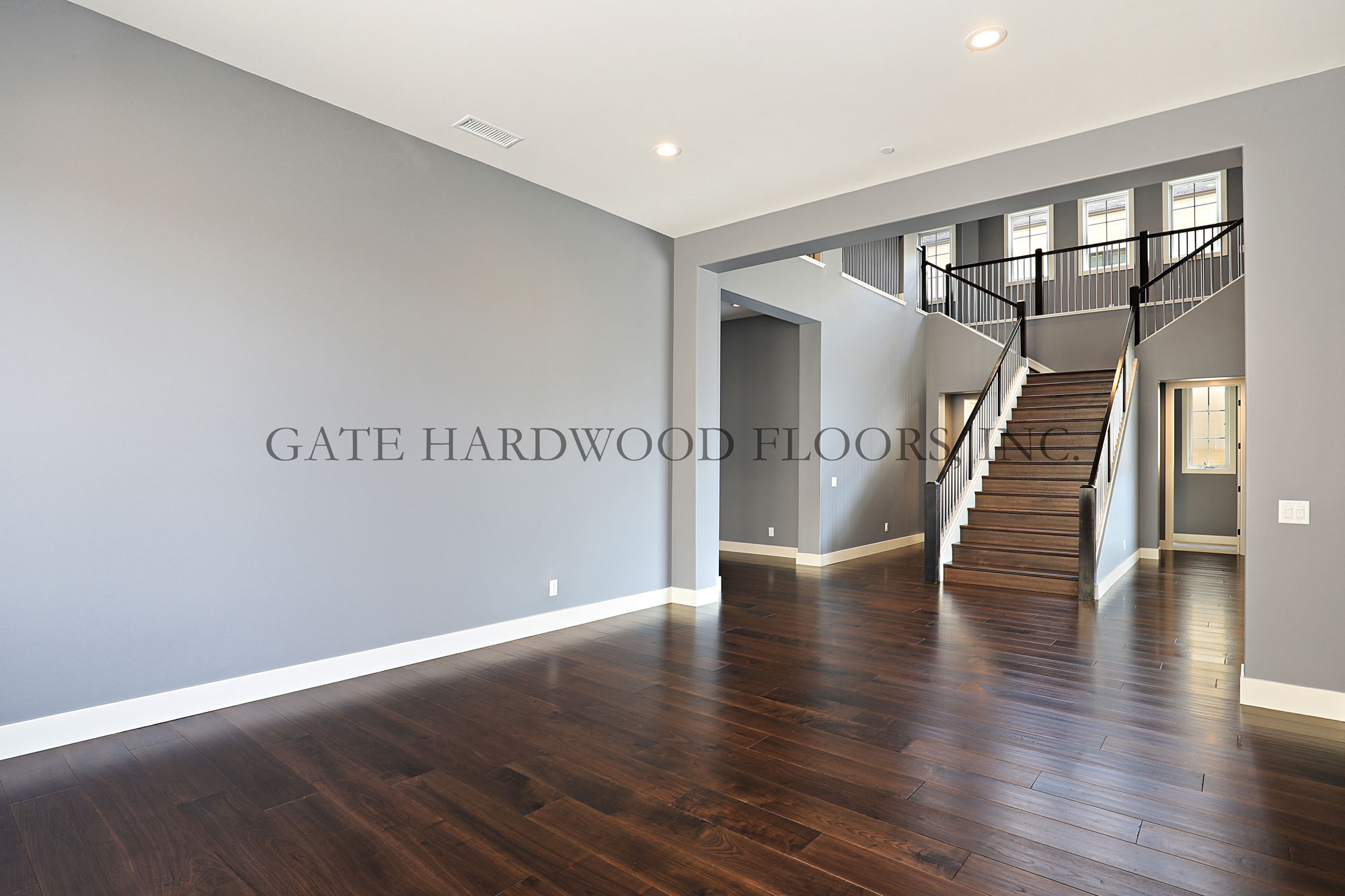 "WalnutClient: HomeownerLocation: IrvineProject Size: 4200 s/f & stair caserSub Straight: 1st floor ¾"" Sika self leveling, 2nd floor ¼"" rubberWood Description: Engineered, ⅝"" x 8"" select grade, American WalnutWood Finish: Light hand scrape, custom color, Loba water-based finish"
